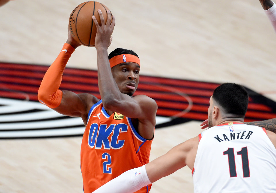 Photo - Jan 25, 2021; Portland, Oregon, USA; Oklahoma City Thunder guard Shai Gilgeous-Alexander (2) looks to pass the ball on Portland Trail Blazers center Enes Kanter (11) during the first quarter at Moda Center. Mandatory Credit: Steve Dykes-USA TODAY Sports