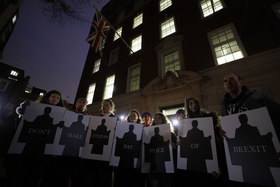 Photo -  Anti-Brexit protesters gather outside the Europe House during a rally in London, Friday, Jan. 31, 2020. Britain officially leaves the European Union on Friday after a debilitating political period that has bitterly divided the nation since the 2016 Brexit referendum. (AP Photo/Kirsty Wigglesworth)