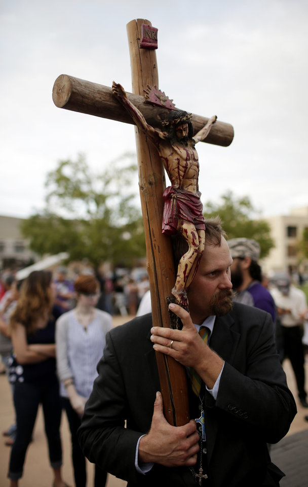Photo - Russell Kargel, of Missouri, protests a Black Mass at the Civic Center Music Hall, Sunday, Sept. 21, 2014.  Photo by Garett Fisbeck, For The Oklahoman