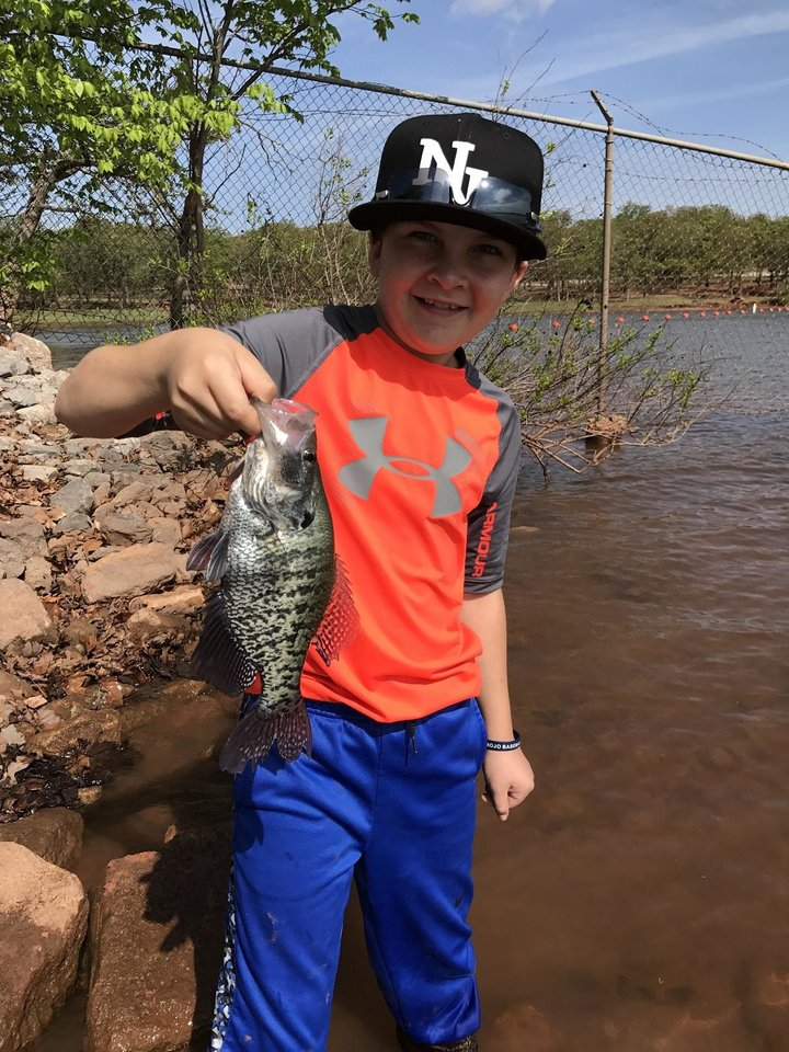 Photo -  Owen Kuklinski, 11, of Norman holds a crappie that he caught at Lake Thunderbird. [PHOTO PROVIDED]