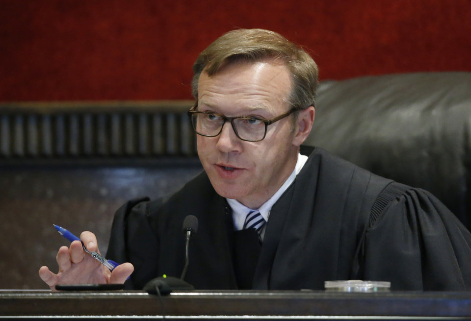 Photo -  Judge Thad Balkman speaks during discussions of the settlement between the state of Oklahoma and Teva Pharmaceutical Industries Ltd. during Oklahoma's trial against drugmakers blamed for contributing to the opioid crisis, Monday, June 10, 2019. [AP photo]