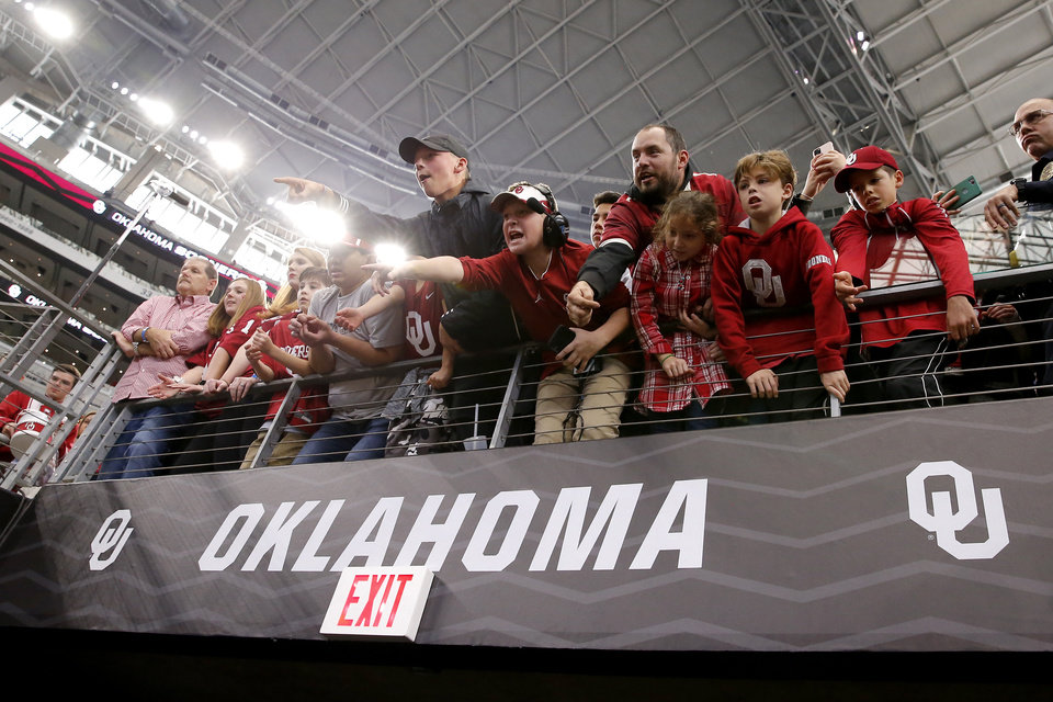 Photo - Oklahoma fans cheer after the Big 12 Championship Game between the University of Oklahoma Sooners (OU) and the Baylor University Bears at AT&T Stadium in Arlington, Texas, Saturday, Dec. 7, 2019. Oklahoma won 30-23. [Bryan Terry/The Oklahoman]