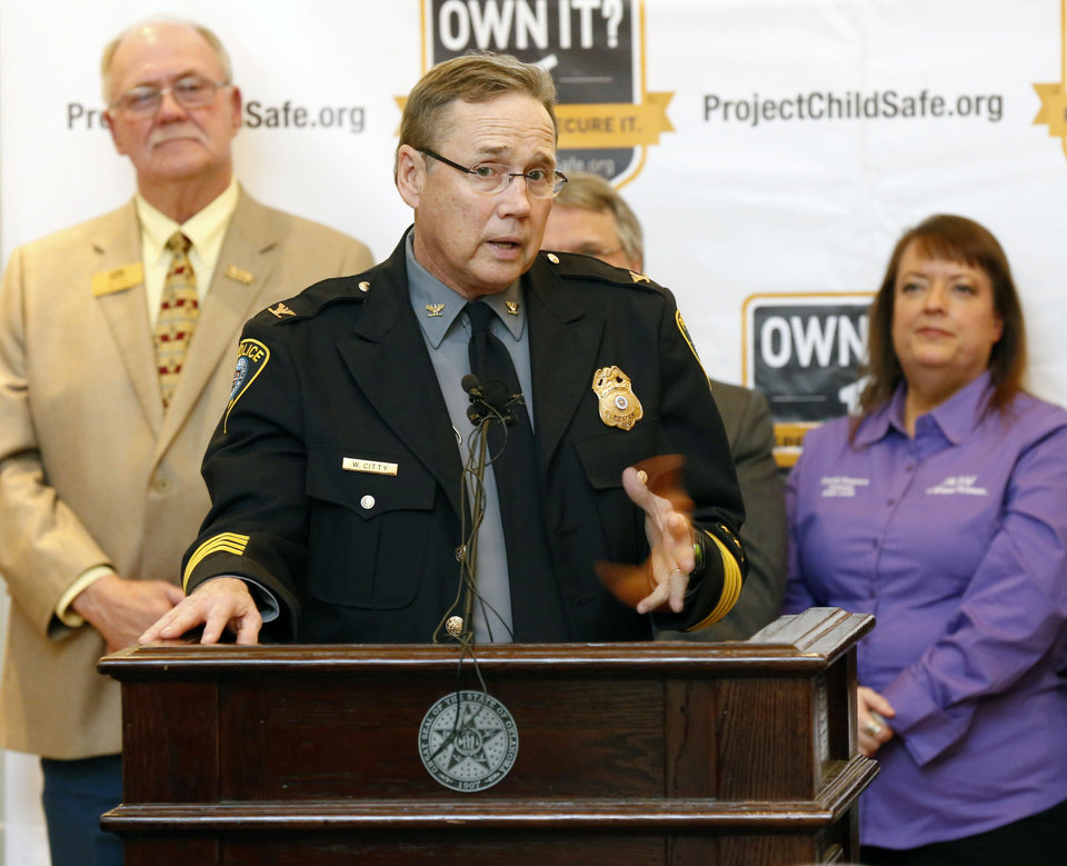 Photo -  Oklahoma City Police Chief Bill Citty speaks Wednesday during a Project Childsafe Communities announcement about providing free gun safety locks to owners of firearms. [Photo by Paul Hellstern, The Oklahoman]