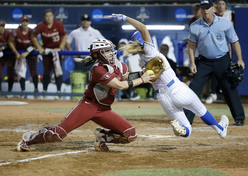 Photo - UCLA's Jacqui Prober (27) slides into home under the tag of Oklahoma's Lynnsie Elam (22) to win the Women's College World Series over Oklahoma at USA Softball Hall of Fame Stadium in Oklahoma City, Tuesday, June 4, 2019. [Sarah Phipps/The Oklahoman]