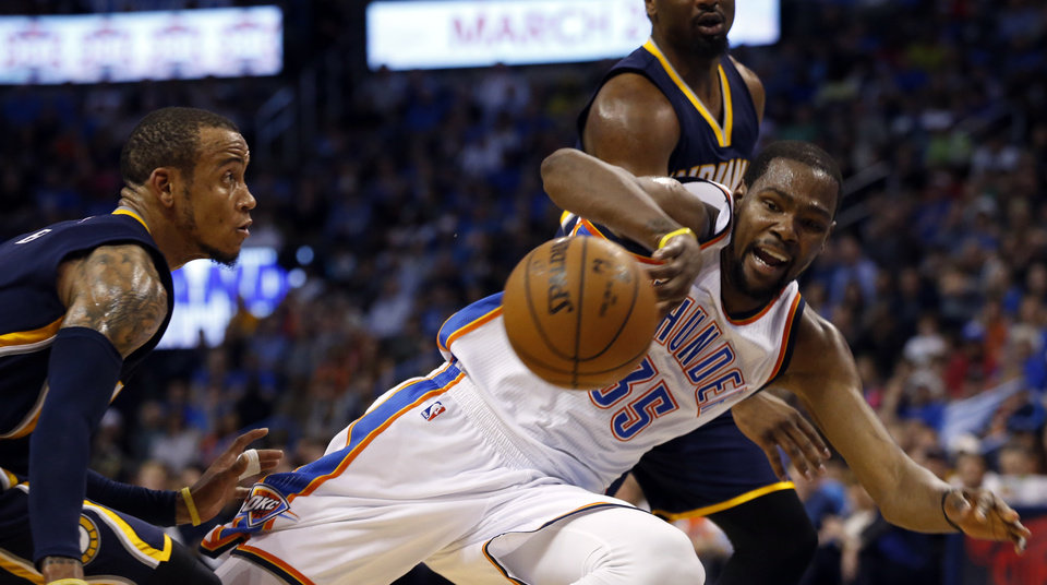 Photo - Oklahoma City Thunder's Kevin Durant (35) goes down on a hard foul in the second half of an NBA basketball game where the Oklahoma City Thunder lost to the Indiana Pacers 101-98 at the Chesapeake Energy Arena in Oklahoma City, on Feb. 19, 2016.  Photo by Steve Sisney The Oklahoman