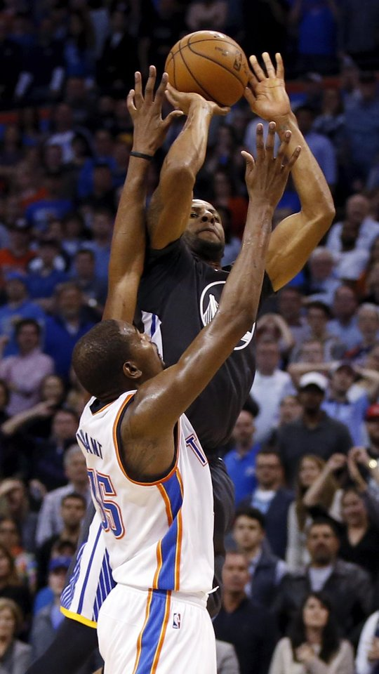 Photo - Oklahoma City's Kevin Durant (35) is called for a foul against Golden State's Andre Iguodala (9) with 0.7 seconds left in regulation during an NBA basketball game between the Oklahoma City Thunder and the Golden State Warriors at Chesapeake Energy Arena in Oklahoma City, Saturday, Feb. 27, 2016. Golden State won 121-118 in overtime. Photo by Nate Billings, The Oklahoman