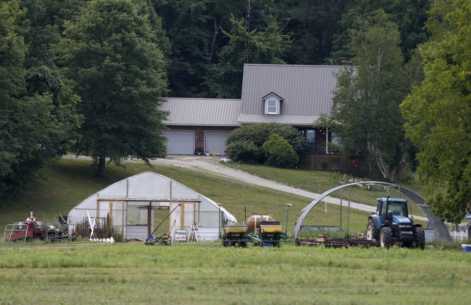 Photo -  Property belonging to Ohio house speaker Larry Householder is seen in rural Glenford, Ohio, Tuesday, July 21, 2020. Householder was taken into custody by federal authorities at the property Tuesday morning as part of a $60 million bribery investigation. (AP Photo/Paul Vernon)