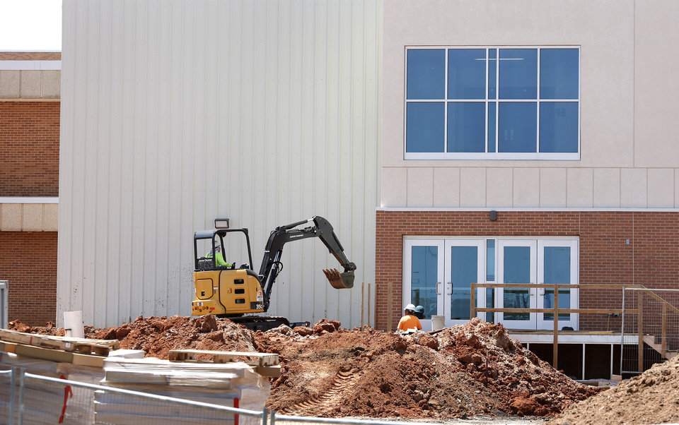 Photo -  Construction continues on a wing added to Moore High School that doubles as a safe room. [Photo by Jim Beckel, The Oklahoman]