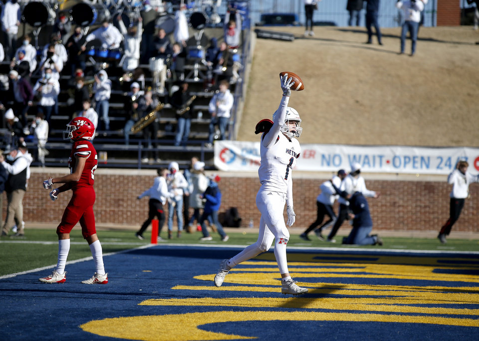 Photo -  Metro Christian's Malachi Penland celebrates a touchdown as Washington's Lane Steele walks off the field at the end of the second quarter Saturday. [Sarah Phipps/The Oklahoman]