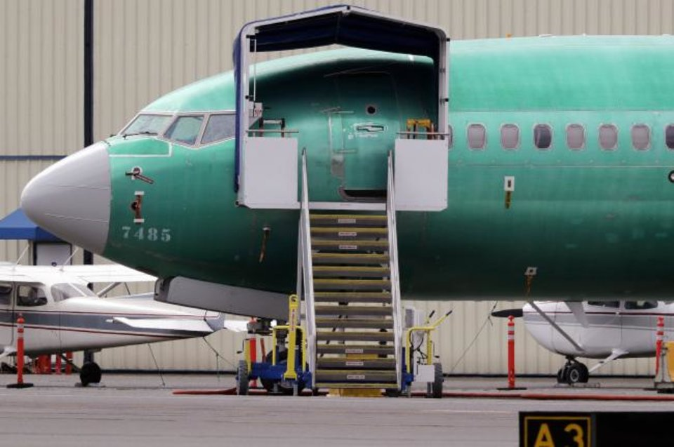 Photo -  A Boeing 737 MAX 7 jet is parked near single engine planes at the airport adjacent to a Boeing Co. production facility in Renton, Wash. [AP PHOTO]