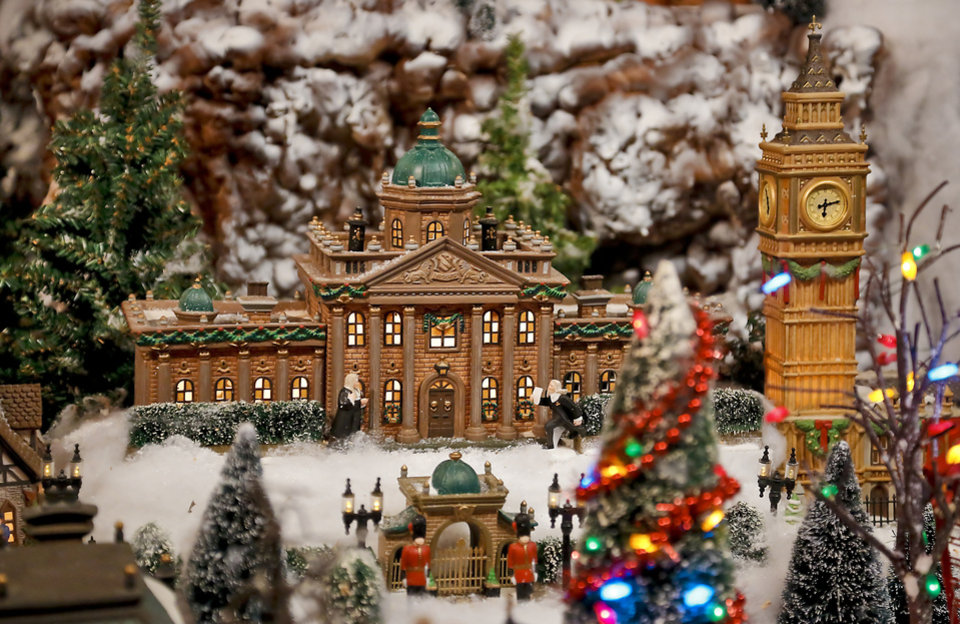 photo areas of the miniature christmas village that is set up in the three car - Miniature Christmas Town Decorations