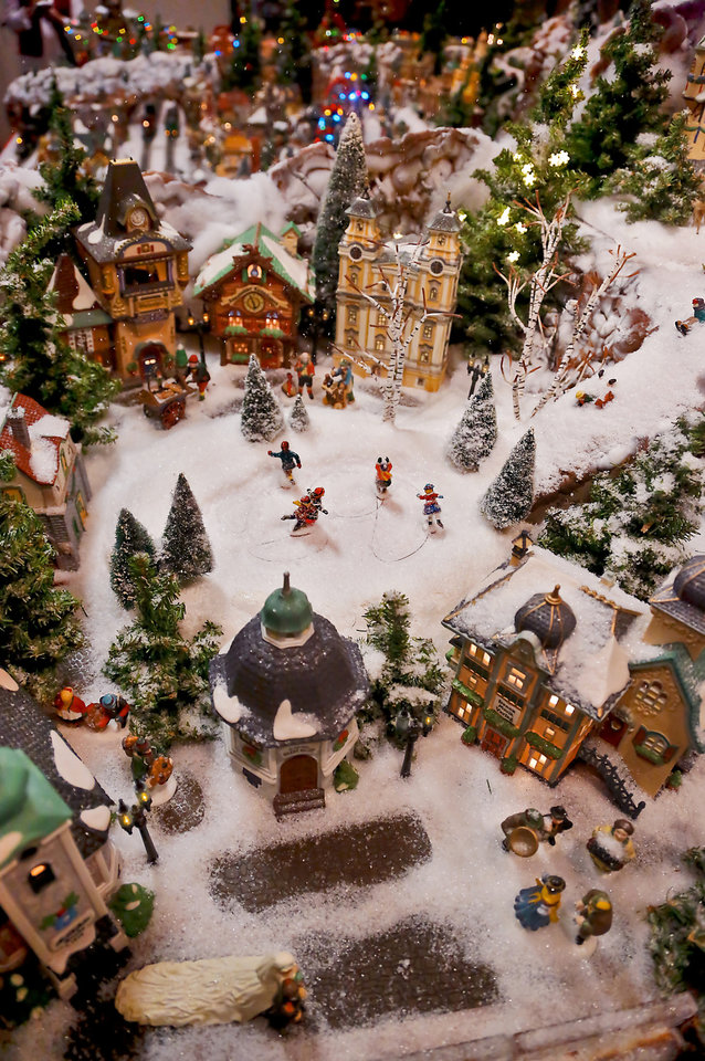 photo areas of the miniature christmas village that is set up in the three car - Miniature Christmas Village