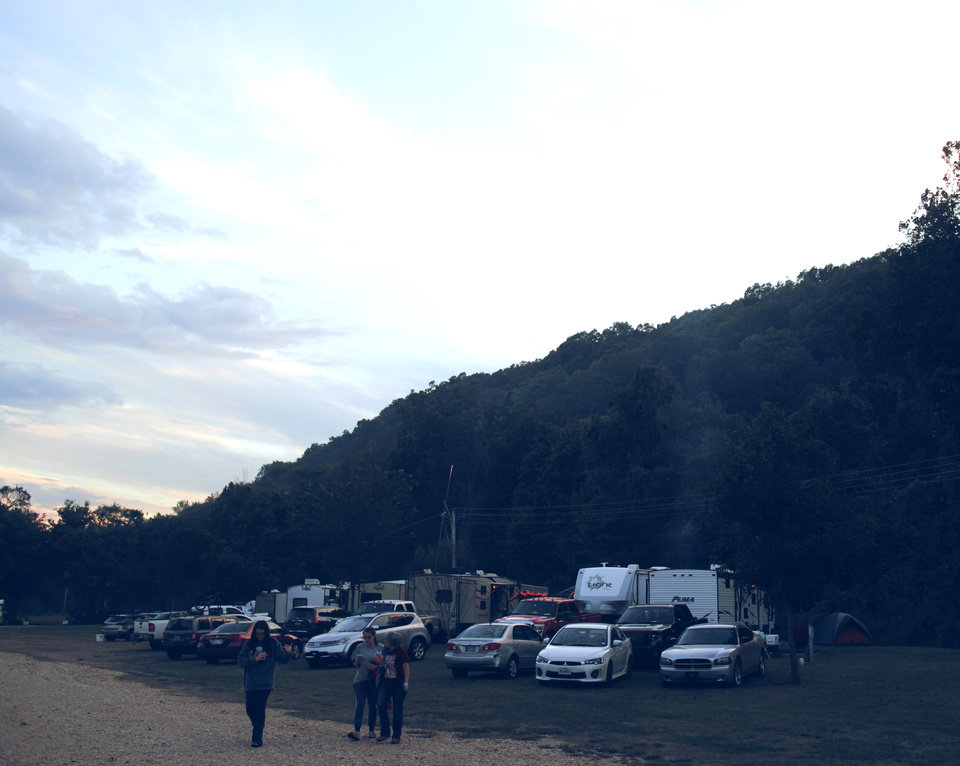 Photo -  Campers and vehicles in the campgrounds at 2017's Illinois River Jam in Tahlequah. [Photo by Nathan Poppe, The Oklahoman]