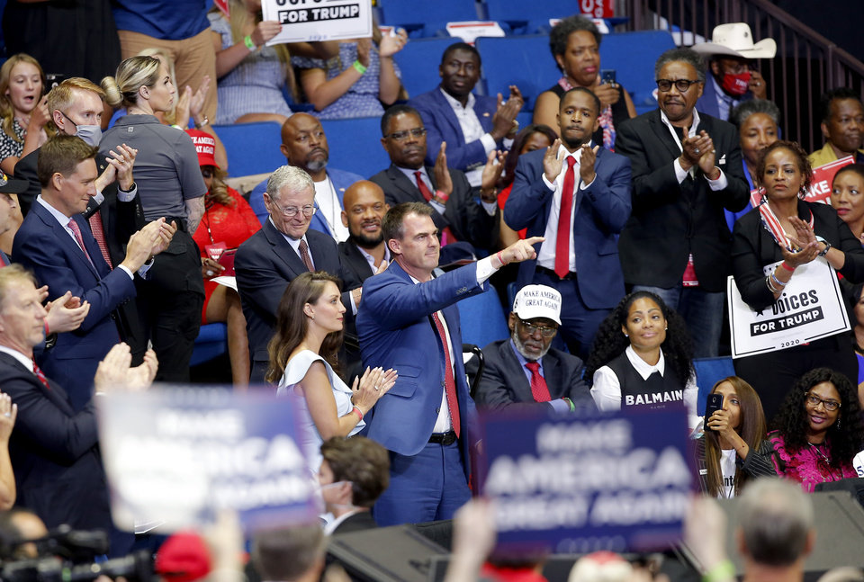 Photo - Gov. Kevin Stitt points to President Donald Trump during a rally at the BOK Center in Tulsa, Okla., Saturday, June 20, 2020. [Sarah Phipps/The Oklahoman]