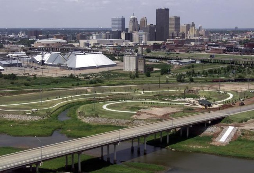 Photo -  The Oklahoma River was still little more than a drainage channel when  trails and a park pavilion were built just west of the Lincoln Avenue bridge over what was then known as the North Canadian River. This would soon become the start of the Boathouse District. [The Oklahoman archives]