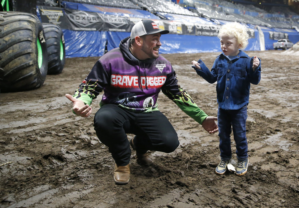 Photo - Monster Jam driver Grave Digger, Brandon Vinson, surprises Ryker Ammons, 4, of Yukon, Okla., with his own Grave Digger truck during a special meet and greet at Chesapeake Energy Arena in Oklahoma City, Friday, Feb. 14, 2020.  [Sarah Phipps/The Oklahoman]