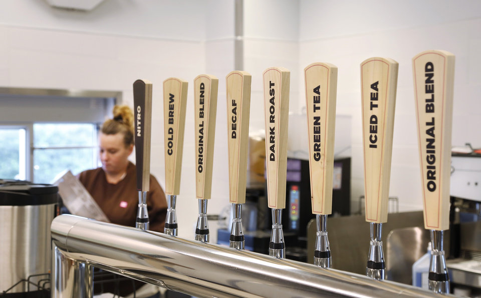 Photo -  A nitro-fed cold coffee and tea tap is among the new-to-market features at the Dunkin' Donuts set to open along Uptown later this month. [Photo by Jim Beckel, The Oklahoman]