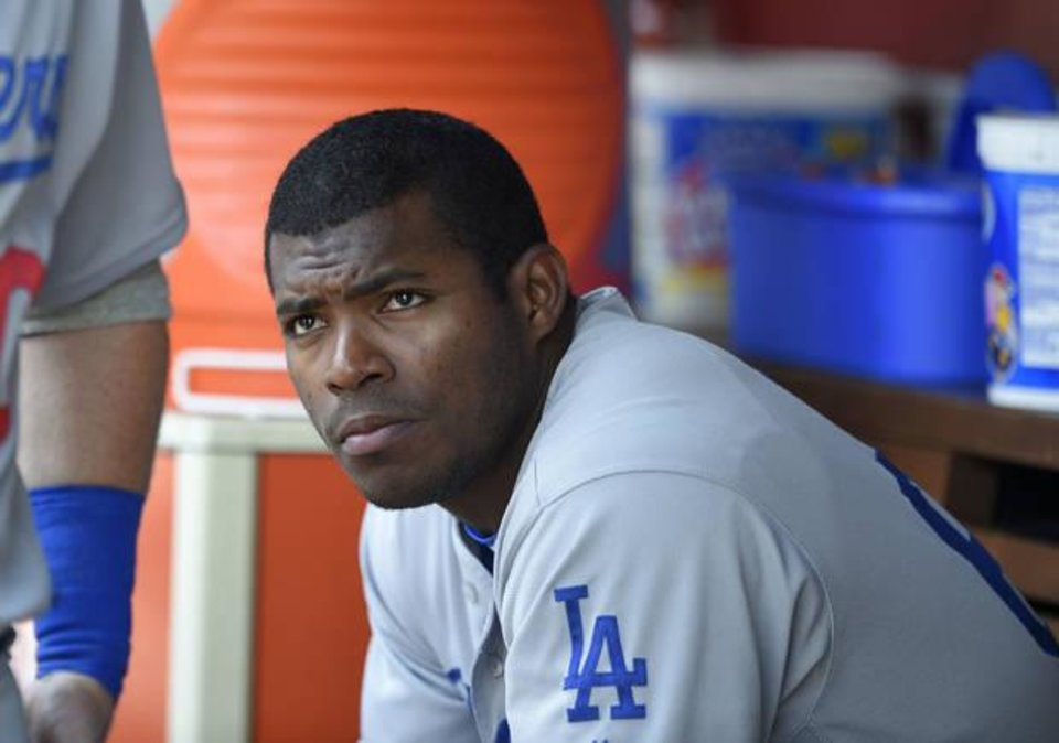 Photo - FILE - This July 21, 2016 file photo shows Los Angeles Dodgers' Yasiel Puig looking on from the dugout during a baseball game against the Washington Nationals in Washington. Puig's agent said Monday, Aug. 1, 2016 the Los Angeles Dodgers slugger expects to be sent to the minors after the club was unable to trade him at the deadline. (AP Photo/Nick Wass)