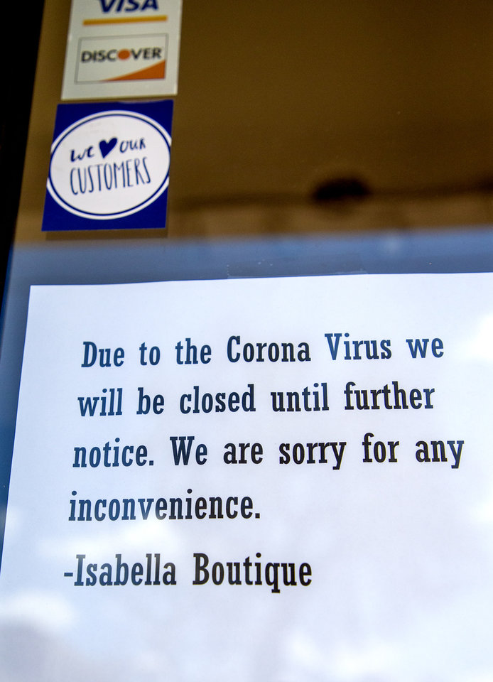 Photo - The Isabella Boutique has posted a temporarily closed sign at its location on SW 29th St. in Oklahoma City, Okla. on Tuesday, March 31, 2020. [Chris Landsberger/The Oklahoman]