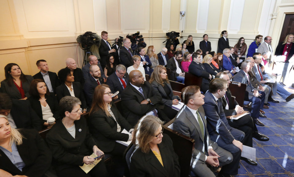 Photo - This hearing room at the Capitol was filled to capacity. Oklahoma Attorney General Mike Hunter can remain on the ballot after the Oklahoma Election Board voted 3-0 on Monday, April 23, 2018, to deny a challenge to his candidacy on residency grounds. Hunter, a Republican, testified he always kept Oklahoma as his permanent home even though he lived in Virginia for years while working in Washington, D.C. for two trade organizations.