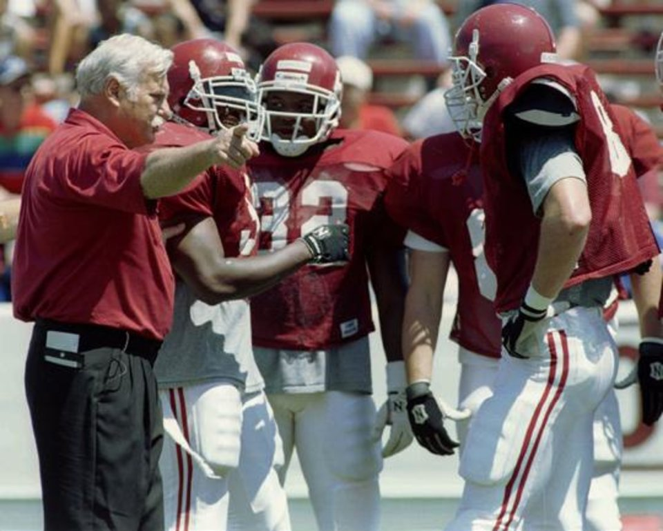 Photo -  OU head football coach Howard Schnellenberger gives the red team an attitude adjustment during the final spring game, the Red-White scrimmage. Staff photo by Steve Gooch