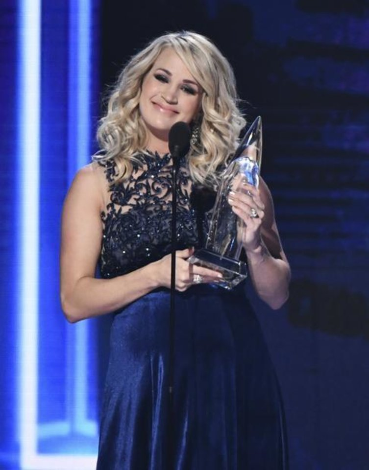 Photo - Carrie Underwood accepts the award for female vocalist of the yea at the 52nd annual CMA Awards at Bridgestone Arena on Wednesday, Nov. 14, 2018, in Nashville, Tenn. AP photo
