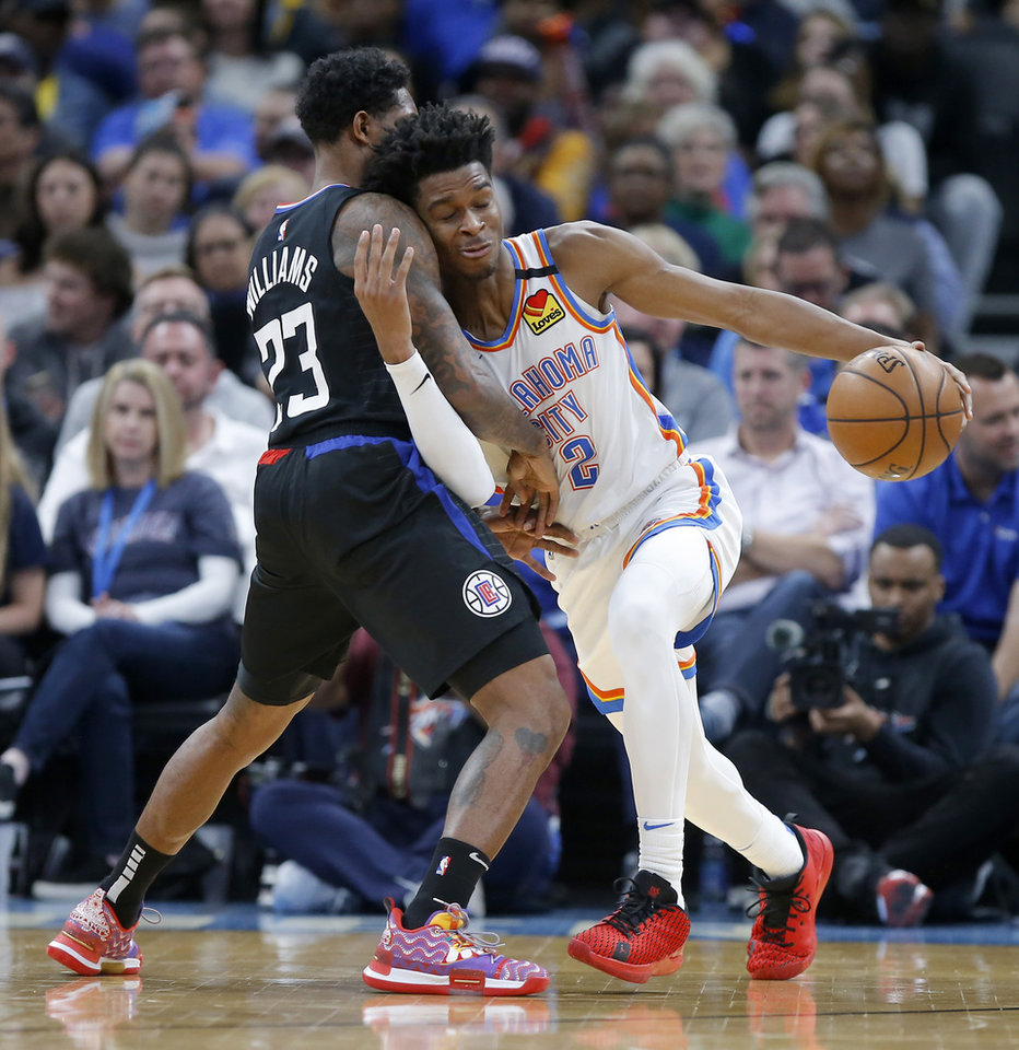 Photo - Oklahoma City's Shai Gilgeous-Alexander (2) tries to get past LA's Lou Williams (23) during an NBA basketball game between the Oklahoma City Thunder and the Los Angeles Clippers at Chesapeake Energy Arena in Oklahoma City, Tuesday, March 3, 2020. [Bryan Terry/The Oklahoman]