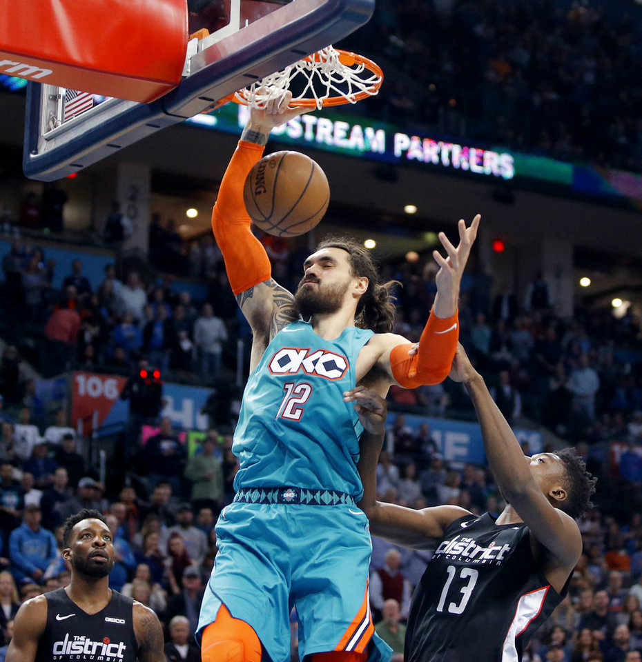 Photo - Oklahoma City's Steven Adams (12) dunks the ball beside Washington's Thomas Bryant (13) as Jeff Green (32) watches during an NBA basketball game between the Oklahoma City Thunder and the Washington Wizards at Chesapeake Energy Arena in Oklahoma City, Sunday, Jan. 6, 2019. Photo by Bryan Terry, The Oklahoman