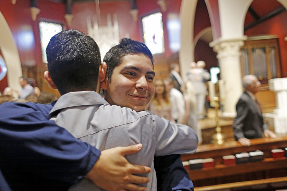 Photo - Joshua is greeted by friends and family after the Teen Recovery Solutions (TRS) at Mission Academy high school graduation ceremony at St. Paul's Episcopal Cathedral, 127 NW 7th, in Oklahoma City, Thursday, May 26, 2016. Photo by Doug Hoke, The Oklahoman