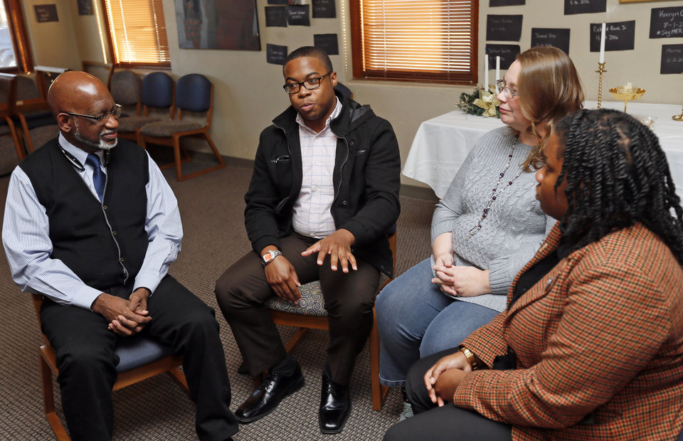 Photo - From left, Community organizers Rev. Gerald L. Davis, Charles Wilkes, Kendra Stewart and Shay White give an interview at Church of the Restoration Unitarian Universalist, 1314 N Greenwood Ave., in Tulsa., Okla., Thursday, Dec. 8, 2016. Photo by Nate Billings, The Oklahoman