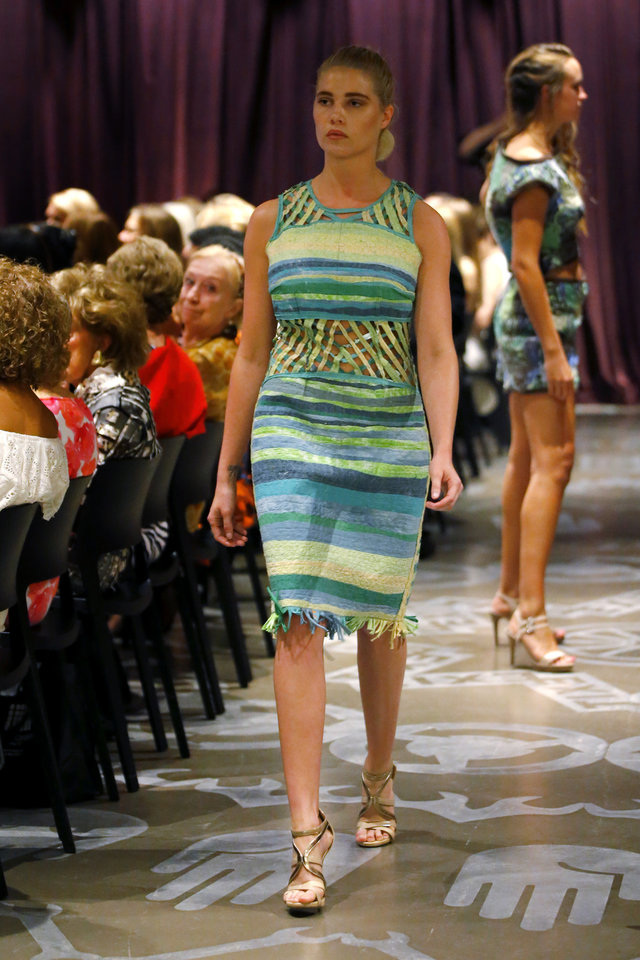 Photo -  Re-CLEM, a line designed by the OSU DHM research team, used upcycled T-shirts to create designs featuring open latticing around the midriff and neckline and bold, fashion-forward patterns. [PHOTO BY BRYAN TERRY, THE OKLAHOMAN]