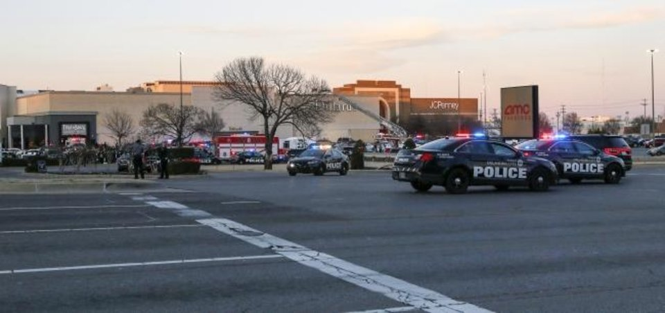 Photo -  Police and fire department vehicles are scattered around the south side of Penn Square Mall on Thursday after a shooting in the mall. [Nate Billings/The Oklahoman]