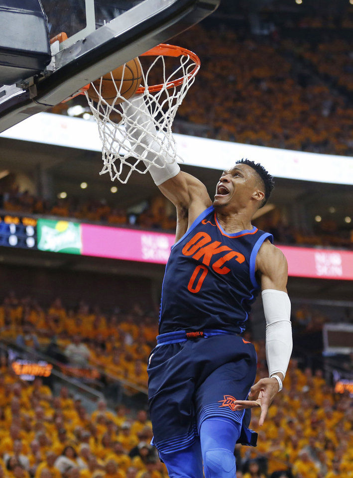 Photo - Oklahoma City Thunder guard Russell Westbrook dunks against the Utah Jazz during the first half of Game 6 in an NBA basketball first-round playoff series Friday, April 27, 2018, in Salt Lake City. (AP Photo/Rick Bowmer)