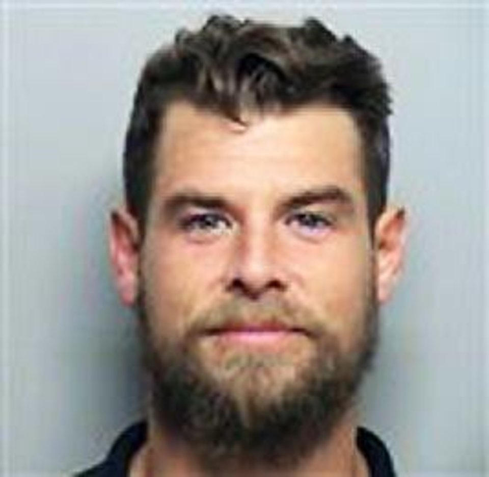 Photo - John Daugherty Daugherty is charged with failing to report an assault.