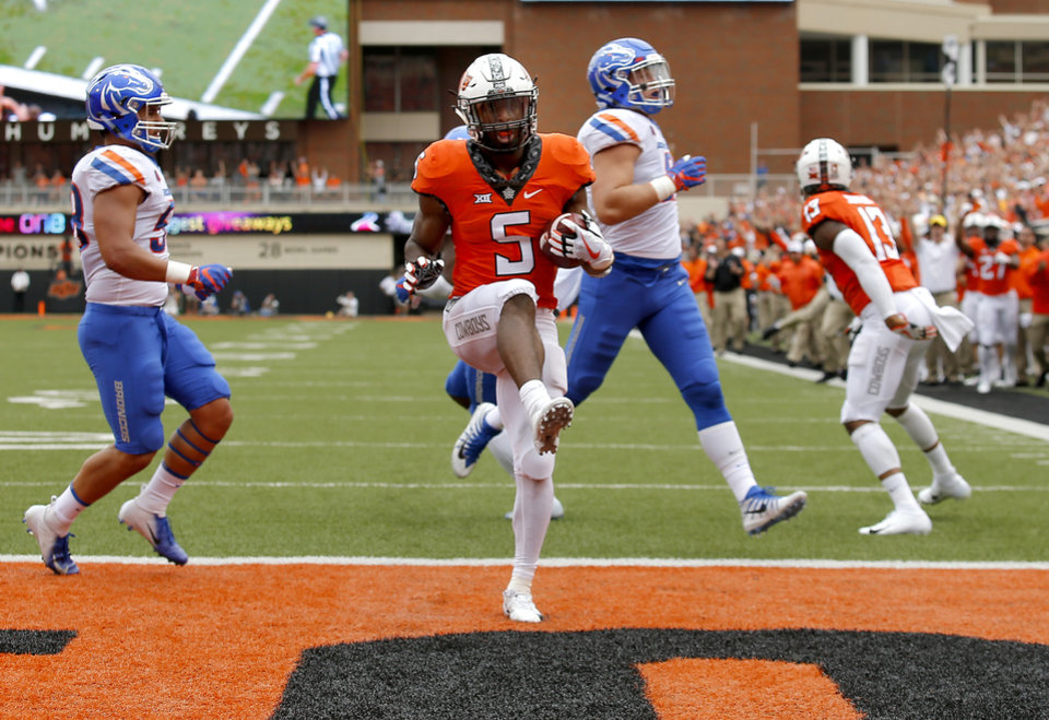 Photo - Oklahoma State's Justice Hill (5) scores a touchdown in the second quarter during a college football game between the Oklahoma State Cowboys (OSU) and the Boise State Broncos at Boone Pickens Stadium in Stillwater, Okla., Saturday, Sept. 15, 2018. Photo by Sarah Phipps, The Oklahoman