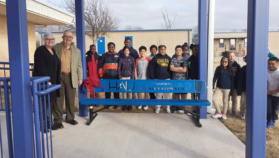 Photo - Suzie and Stan Hupfeld, with students who helped to get the new bench ready for presentation. PHOTO PROVIDED