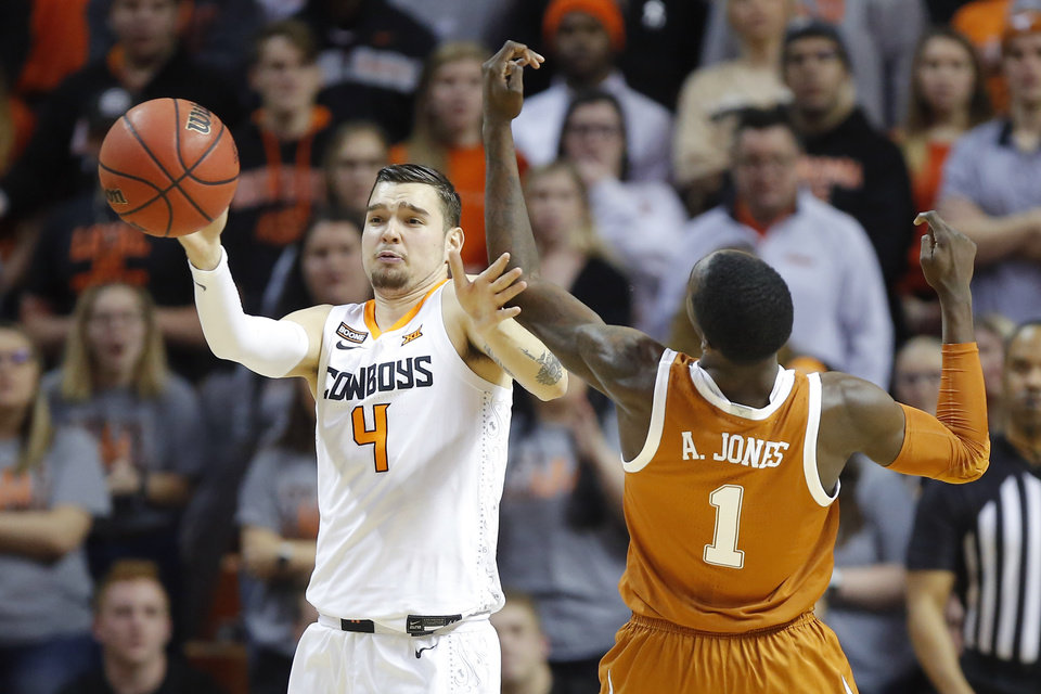 Photo - Oklahoma State's Thomas Dziagwa (4) goes for the ball beside Texas' Andrew Jones (1) during an NCAA basketball game between the Oklahoma State University Cowboys (OSU) and the Texas Longhorns at Gallagher-Iba Arena in Stillwater, Okla., Wednesday, Jan. 15, 2020. [Bryan Terry/The Oklahoman]
