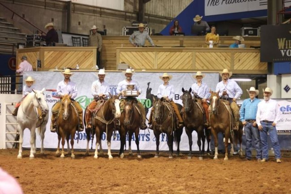 Photo -  McPhail Land & Cattle earned champion team honors at the 2020 Oklahoma Cattlemen's Association Ranch Rodeo.  From left are Drake McPhail (a family member, but not a ranch team member), Rowdy McFall, Miles Baker, Darren Baker, Dane McPhail, Dagan McPhail and Dayton McPhail.  Presenting the Champion trophy and custom spurs are OCA President Mike Weeks and OCA Ranch Rodeo Committee Chair Weston Givens. [PROVIDED BY THE OKLAHOMA CATTLEMEN'S ASSOCIATION]