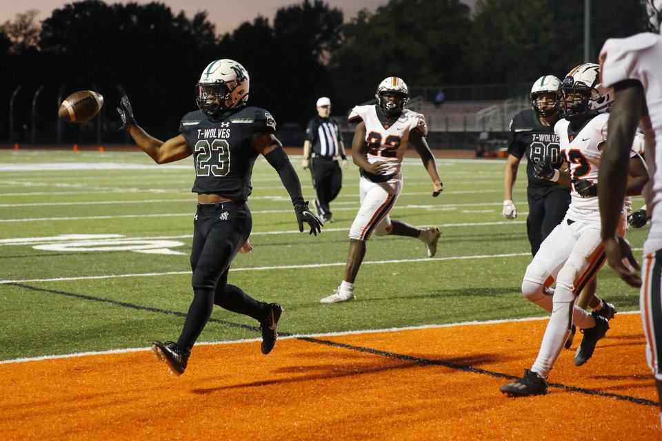 Photo - Norman North's Gabe Trevillison scores a touchdown during a high school football game between Norman North and Putnam City in Norman, Okla., Friday, Oct. 16, 2020. [Bryan Terry/The Oklahoman]