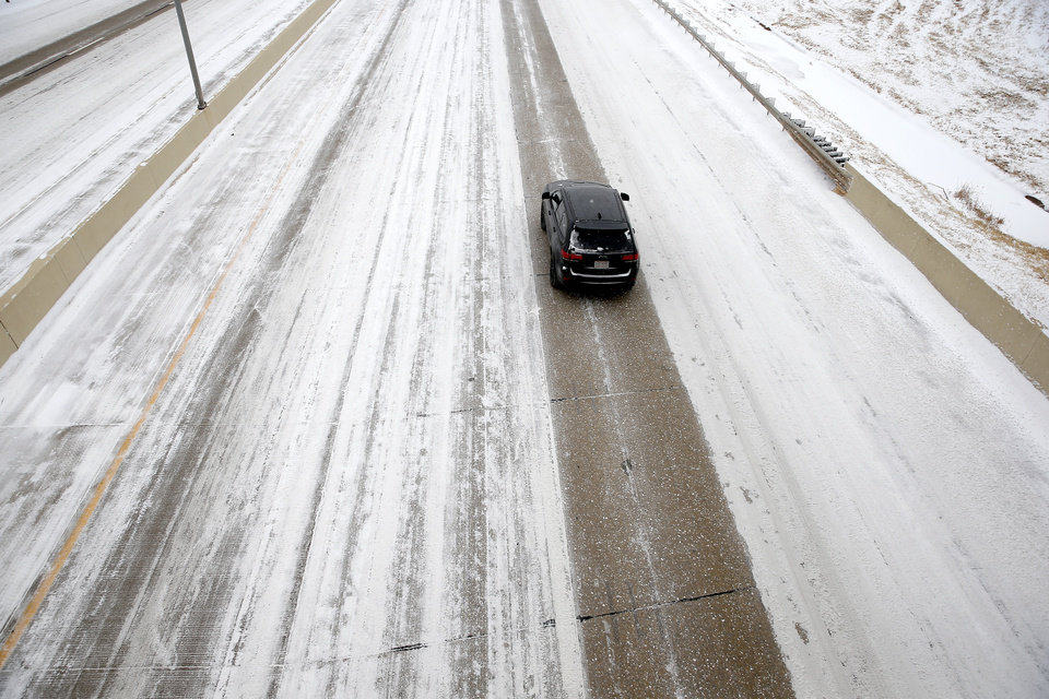 Photo - A car travels east on the Kilpatrick Turnpike in Oklahoma City, Sunday, Feb. 14, 2021. Photo by Sarah Phipps, The Oklahoman