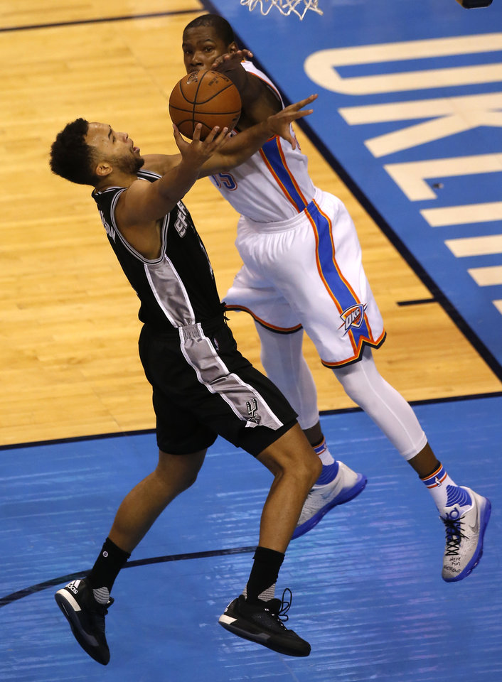 Photo - Oklahoma City's Kevin Durant (35) defends against San Antonio's Kyle Anderson (1) during Game 4 of the Western Conference semifinals between the Oklahoma City Thunder and the San Antonio Spurs in the NBA playoffs at Chesapeake Energy Arena in Oklahoma City, Sunday, May 8, 2016. Photo by Sarah Phipps, The Oklahoman
