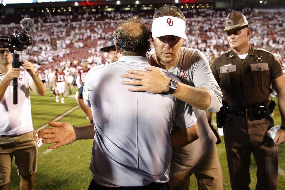 Photo - Oklahoma coach Lincoln Riley greets Houston coach Dana Holgorsen after a college football game between the University of Oklahoma Sooners (OU) and the Houston Cougars at Gaylord Family-Oklahoma Memorial Stadium in Norman, Okla., Sunday, Sept. 1, 2019. Oklahoma won 49-31. [Bryan Terry/The Oklahoman]