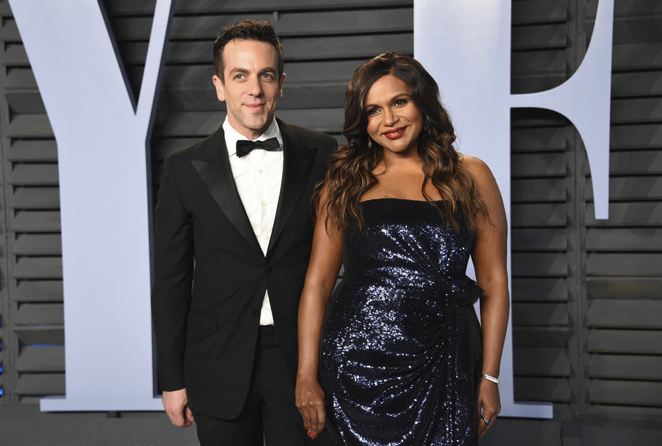 Photo - B.J. Novak, left, and Mindy Kaling arrive at the Vanity Fair Oscar Party on Sunday, March 4, 2018, in Beverly Hills, Calif. (Photo by Evan Agostini/Invision/AP)