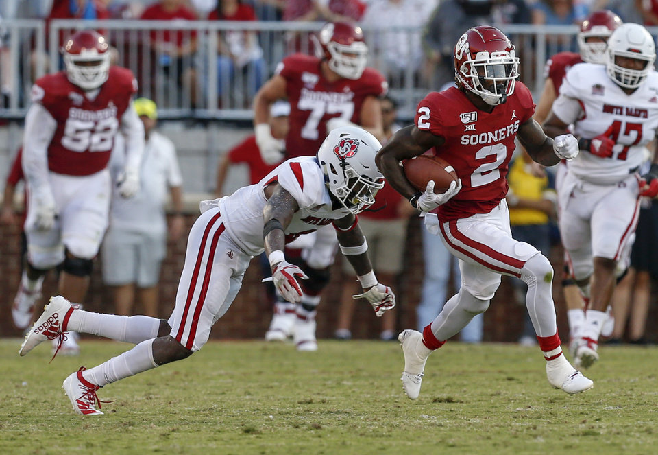 Photo - Oklahoma's CeeDee Lamb (2) runs after a catch from South Dakota's Elijah Reed (4) in the second quarter during a college football game between the Oklahoma Sooners (OU) and South Dakota Coyotes at Gaylord Family - Oklahoma Memorial Stadium in Norman, Okla., Saturday, Sept. 7, 2019. [Nate Billings/The Oklahoman]