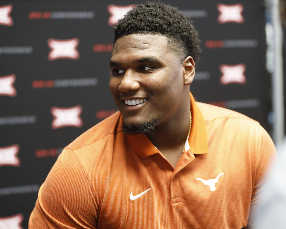 Photo - Texas defensive end Malcolm Roach speaks during Big 12 Conference NCAA college football media day Tuesday, July 16, 2019, at AT&T Stadium in Arlington, Texas. (AP Photo/David Kent)