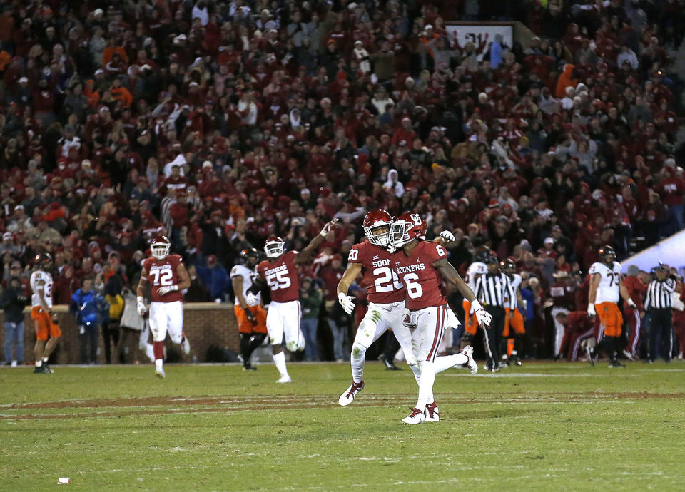Photo - Oklahoma's Robert Barnes (20) and Tre Brown (6) celebrates after Oklahoma State failed to convert on a 2-point play in the fourth quarter during a Bedlam college football game between the University of Oklahoma Sooners (OU) and the Oklahoma State University Cowboys (OSU) at Gaylord Family-Oklahoma Memorial Stadium in Norman, Okla., Nov. 10, 2018.  OU won 48-47. Photo by Sarah Phipps, The Oklahoman