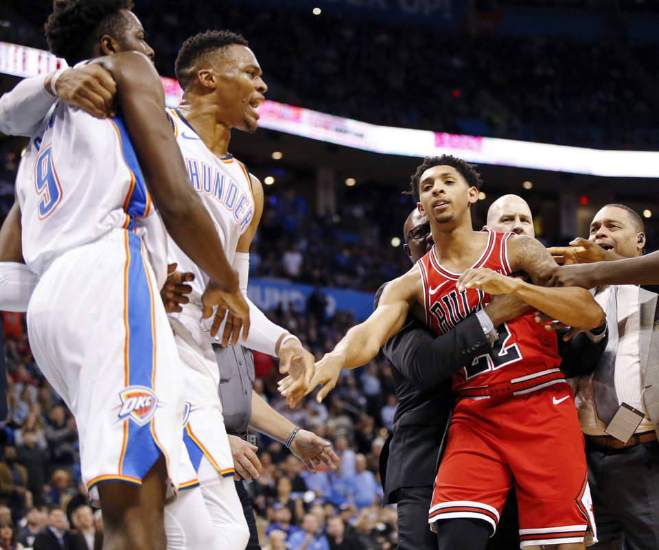 Photo - Oklahoma City's Jerami Grant (9) and Russell Westbrook (0) pull away from Chicago's Cameron Payne (22) after a fight broke out in the third quarter during an NBA basketball game between the Chicago Bulls and the Oklahoma City Thunder at Chesapeake Energy Arena in Oklahoma City, Monday, Dec. 17, 2018. Oklahoma City won 121-96. Photo by Nate Billings, The Oklahoman