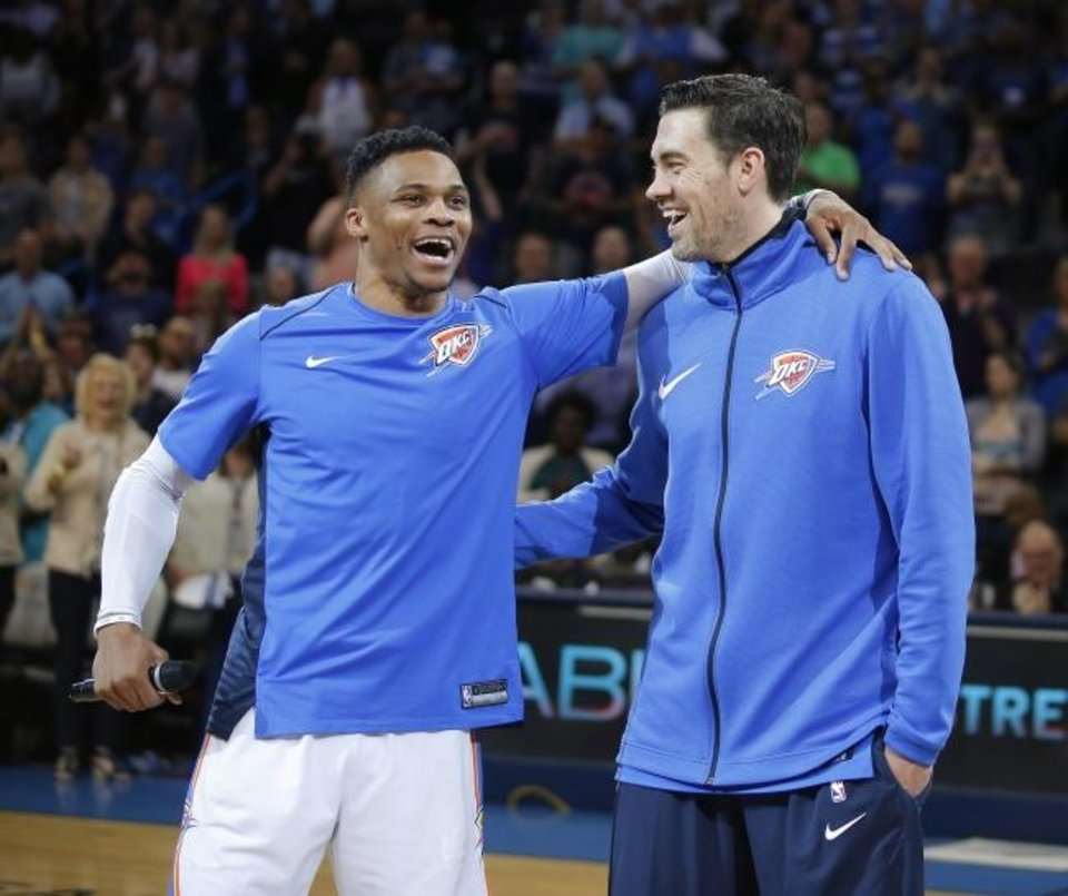 Photo -  Russell Westbrook , left, speaks to the crowd standing beside Nick Collison last April before Collison's final regular-season NBA game. Collison's jersey will be retired on Wednesday night. [Bryan Terry/The Oklahoman]