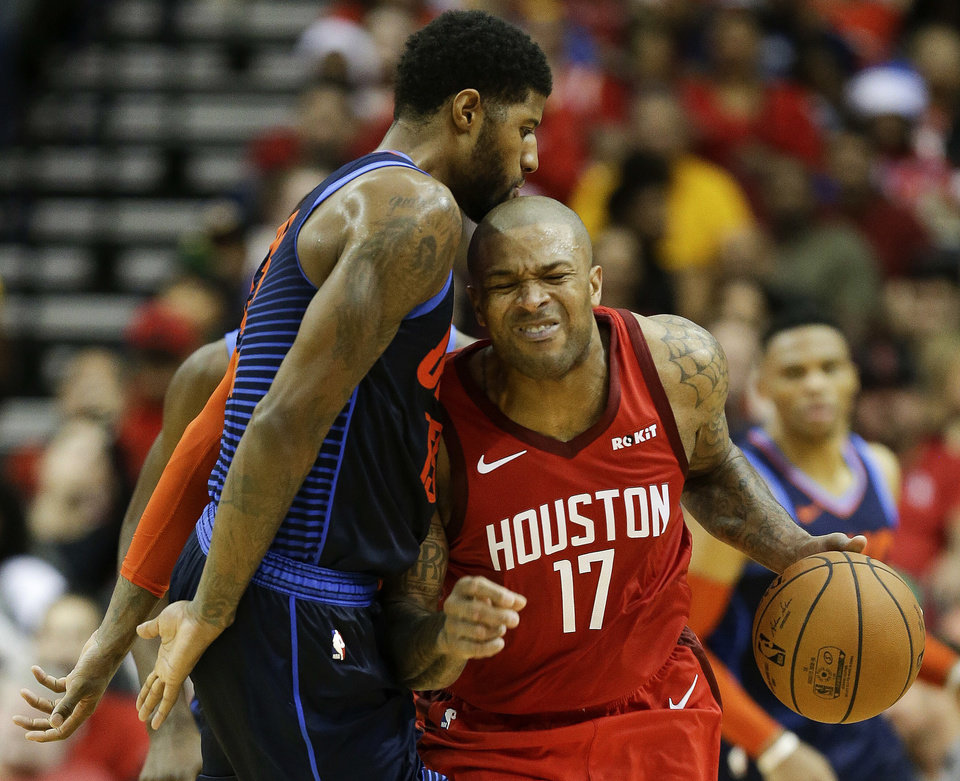 Photo -  Houston Rockets forward P.J. Tucker, right, is fouled by Oklahoma City Thunder forward Paul George during a Christmas Day game in Houston The Rockets won the game, 113-109. [AP PHOTO]
