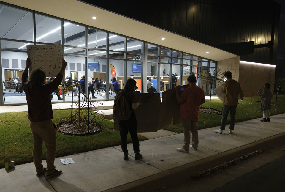 Photo - Protesters line the sidewalk outside at the first live Oklahoma City School Board meeting in the new Clara Luper Center for Educational Services, Monday, November 9, 2020. [Doug Hoke/The Oklahoman]